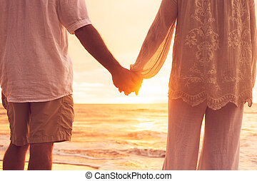 Senior Couple Holding Hands Enjoying at Sunset - Romantic...