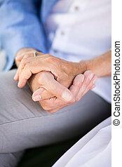 Senior couple holding hands - Close-up of loving senior...