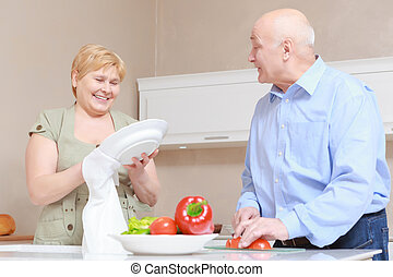 Senior couple housekeeping at home