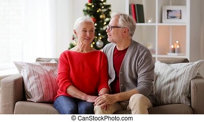 senior couple hugging and kissing at christmas - christmas,...