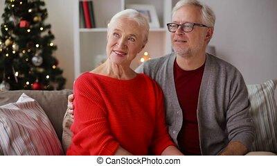 senior couple hugging and kissing at christmas - christmas,...