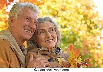 Senior couple hugging
