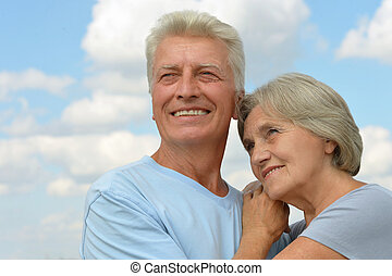senior couple hugging outdoors