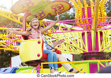 Senior couple in amusement park
