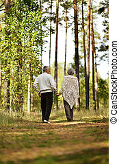 Senior couple in autumn forest
