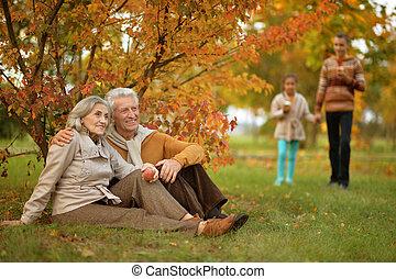 senior couple in autumnal park