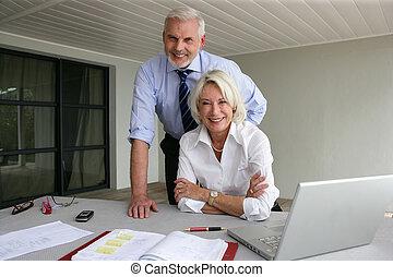 Senior couple in business