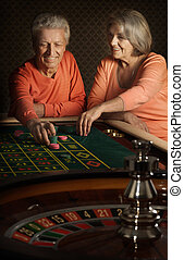 Senior couple in casino