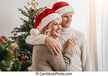 senior couple in santa hats