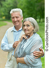 Senior couple in summer park