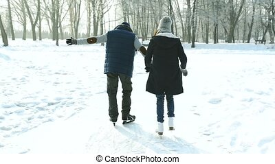 Senior couple in sunny winter nature ice skating. -...