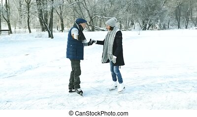 Senior couple in sunny winter nature ice skating. Beautiful...