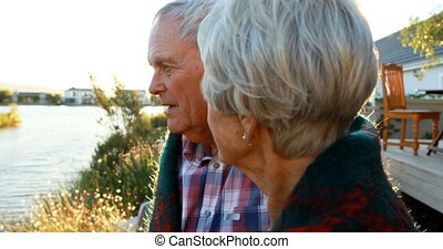 Senior couple interacting with each other in backyard 4k