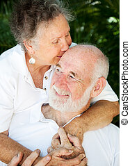 Senior Couple - Kiss for Husband - Senior woman giving her...