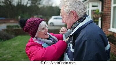 Senior Couple Kissing - Senior woman is kissing her husband...