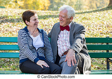 Senior couple laughing in park