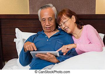 Senior couple learn new technology