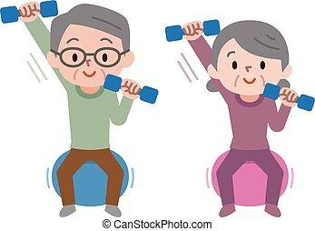 Senior couple lifting dumbbells while sitting on exercise ball