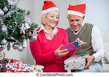 Senior Couple Looking At Christmas Presents