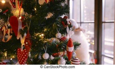 Senior couple looking at Christmas tree at home.