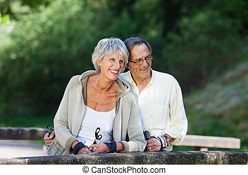 Senior Couple Looking Away While Hiking