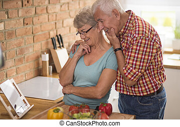 Senior couple looking for inspiration on the Internet