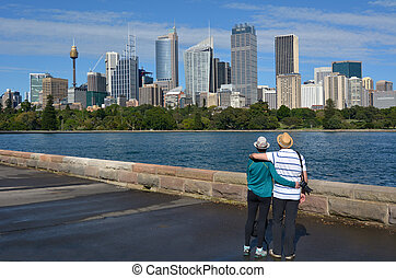 Senior Couple looks at Sydney Central Business District skylin Sydney New South Wales Australia