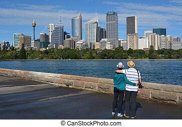 Senior Couple looks at Sydney Central Business District skylin Sydney New South Wales Australia