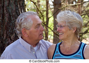 Senior couple - Lovely senior couple together looking at...