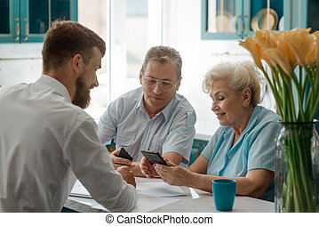 Senior couple making a decision with help of an advisor