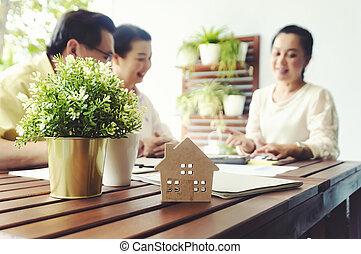 Senior couple meeting financial adviser for investment, ...