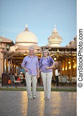 Senior couple near hotel resort - Portrait of a senior...