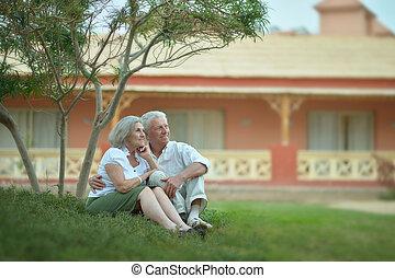 Senior couple near hotel - Portrait of a senior couple...