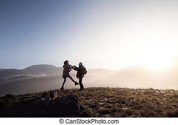 Senior couple on a walk in an autumn nature. - Active senior...