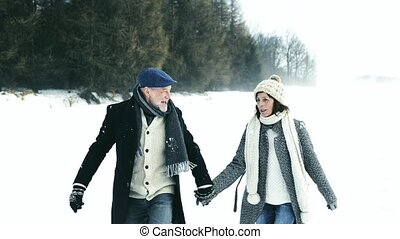Senior couple on a walk on winter day.