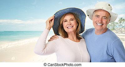 Senior couple on beach.