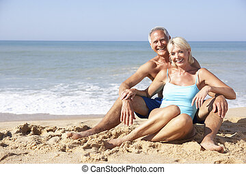 Senior couple on beach holiday