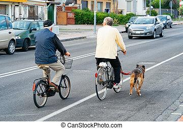 Senior couple on bicycles Santa Teresa di Riva Messina Sicily