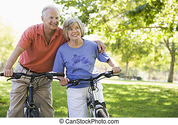 Senior couple on bicycles