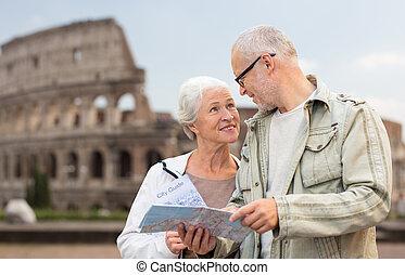 senior couple on city street - family, age, tourism, travel ...