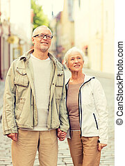 senior couple on city street