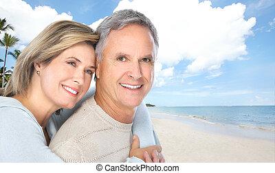 Senior couple on the beach.
