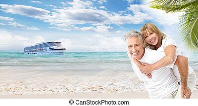Happy Senior couple on the beach. Vacation.