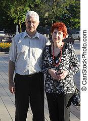 Senior couple outdoor. Still love each other.