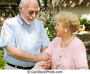 Senior Couple Outdoors - Loving senior couple enjoying a...
