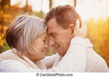 Senior couple outside - Active seniors on a walk in autumn...