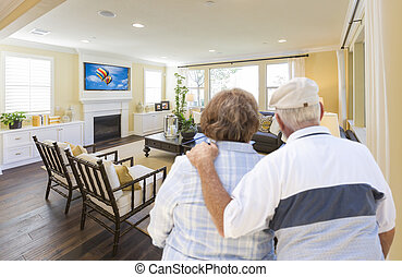 Senior Couple Overlooking A Beautiful Living Room -...