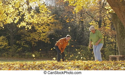 senior couple pelting with foliage