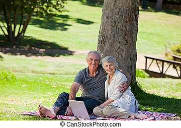 Senior couple  picnicking in the garden