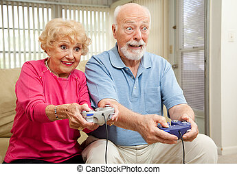 Senior Couple Play Video Games - Senior couple having a...